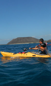 Sea Kayak with Lobos Island Fuerteventura in background