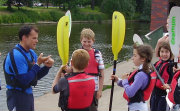 Young kayakers taking instruction