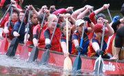 dragon boat paddlers using canoe paddles