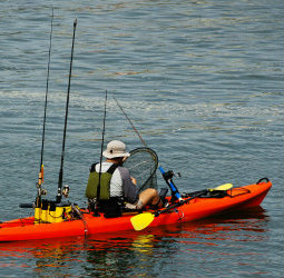 Red Fishing Kayak with all the fishing gear
