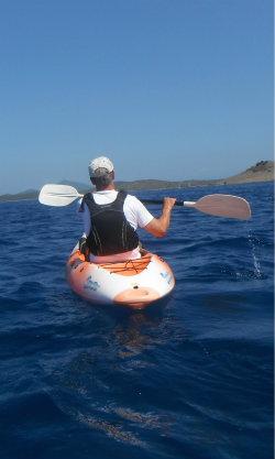 Paddler on Sit onTop Kayak in the sun