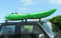 Green Kayak on roof of car