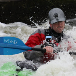 whitewater kayaker on the water