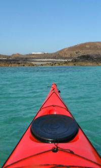 turquoise sea and red sea kayak