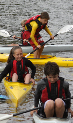 Young paddlers wearing buoyancy aids