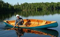 Man steers Canadian Canoe on Still lake