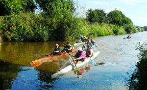 kayaks cruising on beautiful river