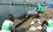 Parents hleping to sort out boat fittings ready to race