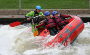 Paddlers having fun in a raft up on edge