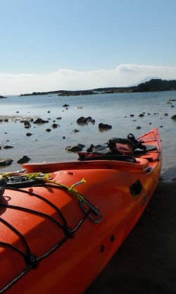 sea kayak on deserted beach