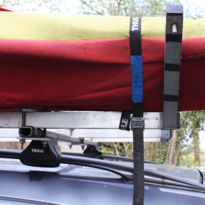 Straps tying kayak on roof rack