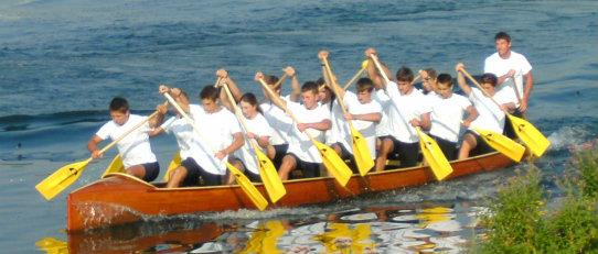 war canoe being paddled